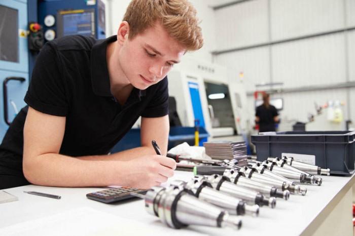 Mechanical engineer at desk - Training Teknik Kalibrasi (Massa, Suhu, Dimensi & Volumetrik)